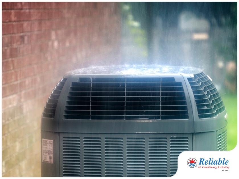 hvac air conditioner outdoor unit in the rain