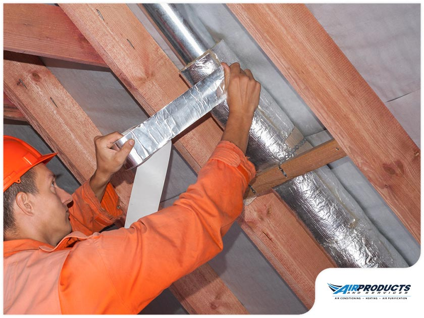 contractor working on hvac duct