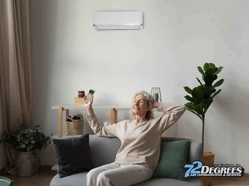elderly homeowner enjoying cool air indoors mini split ac repair