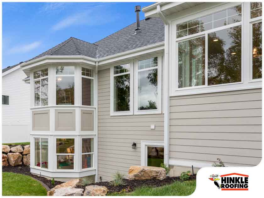 white window trim against grey siding
