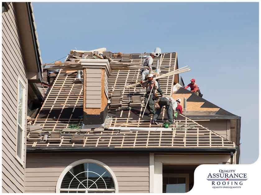 contractors installing new roof
