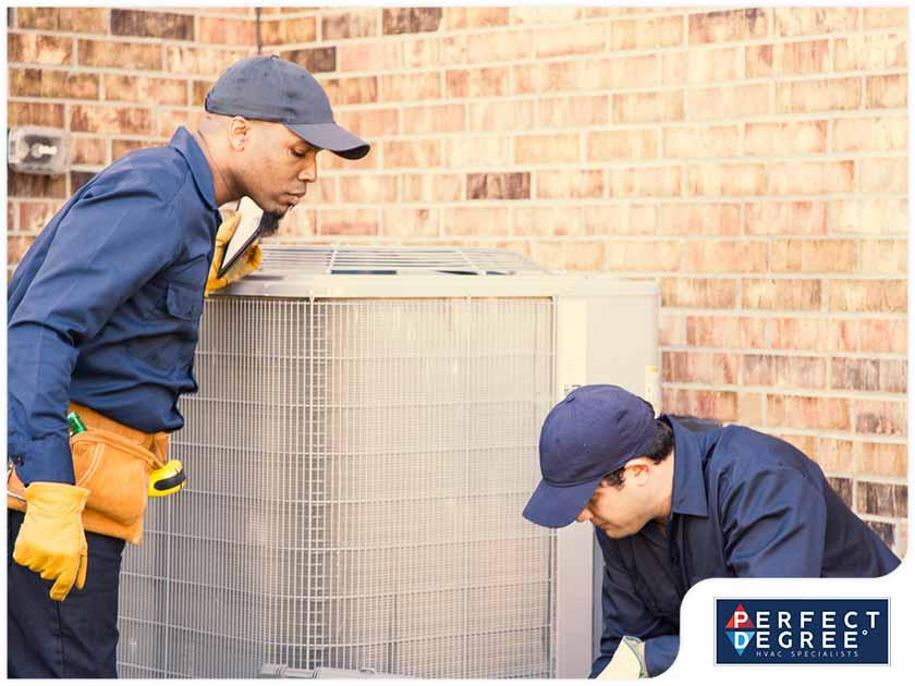 hvac technicians inspecting air conditioner outdoor unit hvac installation