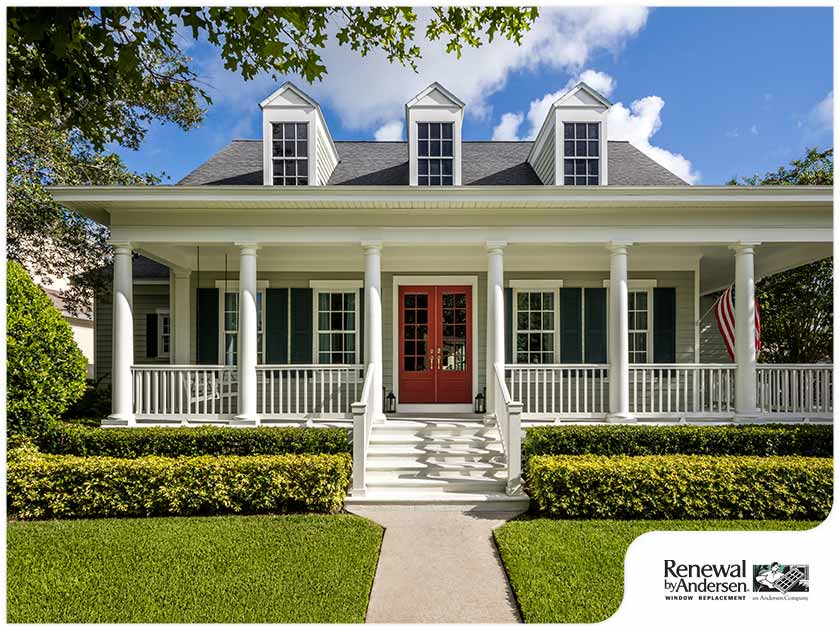 colonial style home green landscaping traditional windows