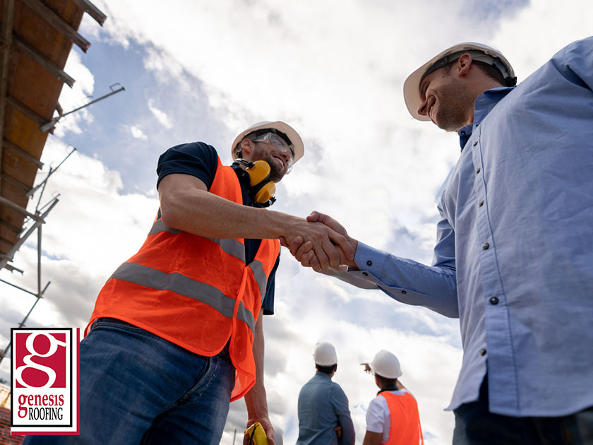 shaking hands roofer and client