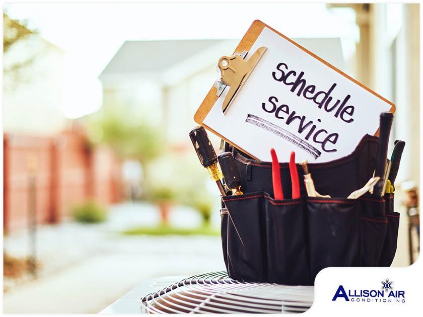 hvac technician tool belt air conditioning outdoor unit schedule service