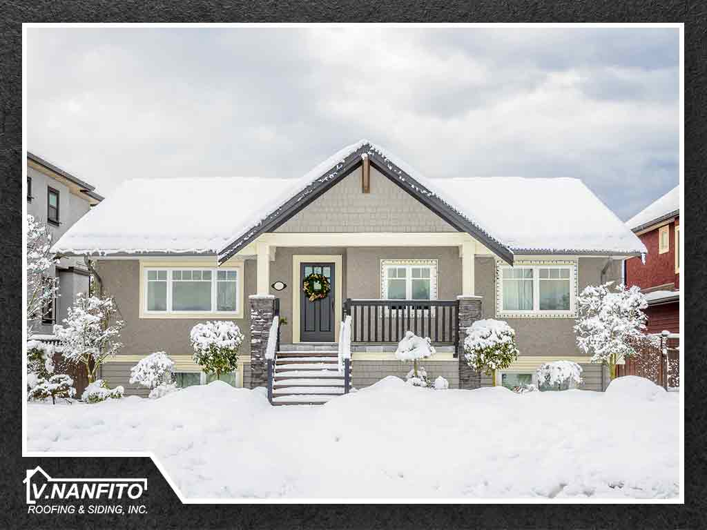 How to Battle Ice and Snow Accumulation on Your Roof